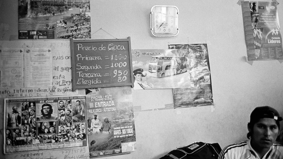 A chalkboard lists the day's prices for coca - according to the quality of the leaves - in the Villa Fátima legal coca market in La Paz.