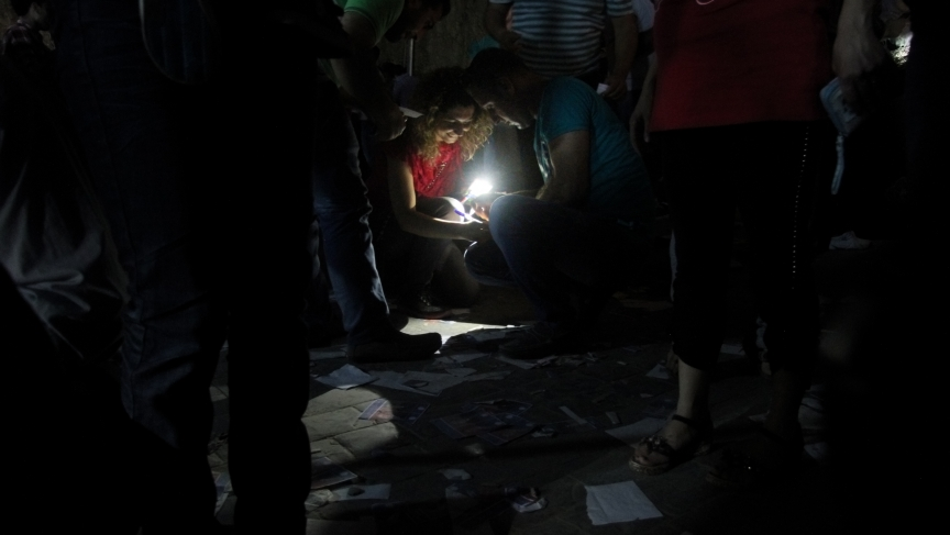 As the sun went down, voters at the Syrian Embassy in Beirut filled out ballots by the light of cellphones and flashlights. The Floors of the polling station were littered with scraps of discarded ballots.