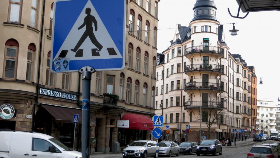 Ample streets signs mark pedestrian crossings in Stockholm.