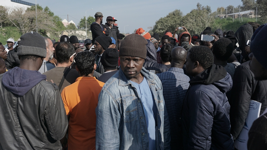 A group of African migrants, including English-speaking Cameroonians, protests against the deportation of asylum-seekers on the Greek island of Lesbos.