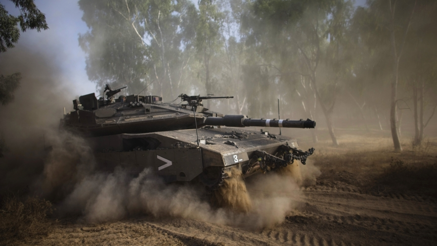 An Israeli tank performs a maneuver after the end of a five-hour humanitarian truce, near the border with the Gaza Strip. Israeli leaders ordered a ground operation in Gaza soon after the temporary ceasefire, which was not honored by Palestinian militant