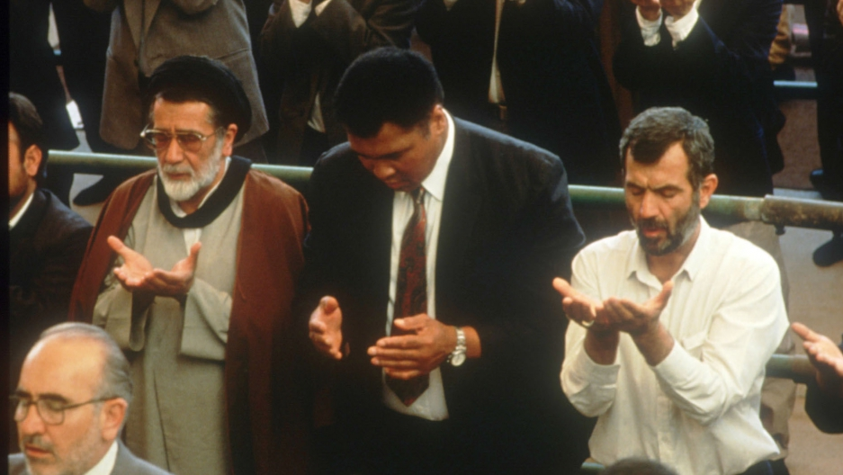 Muhammad Ali attends a religious service during his May 8, 1993 visit to Teheran, Iran.