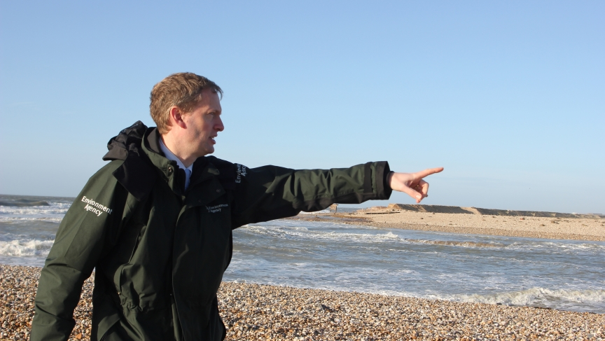 Andrew Gilham of the UKs Environment Agency points to an area of land designated to be returned to the sea