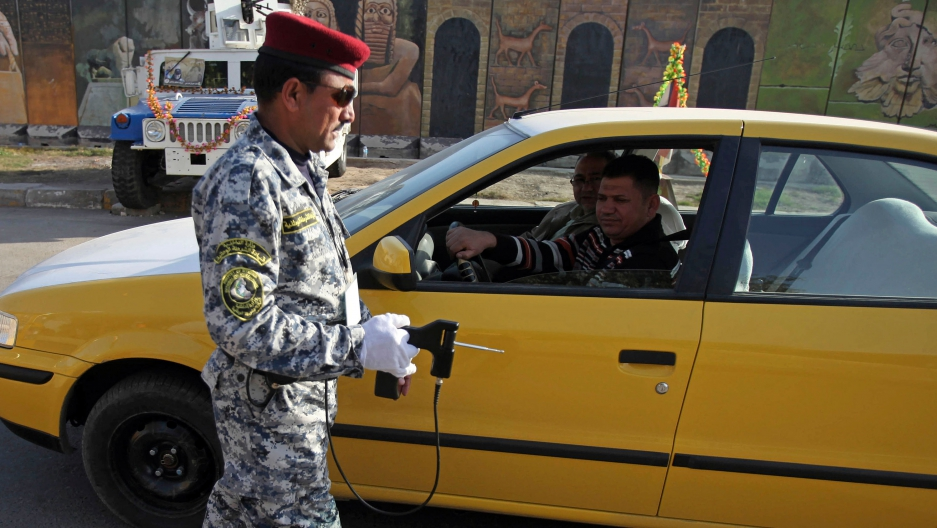 An Iraqi police officer uses the device to inspect a car at checkpoint in central Baghdad, Iraq, 2010.