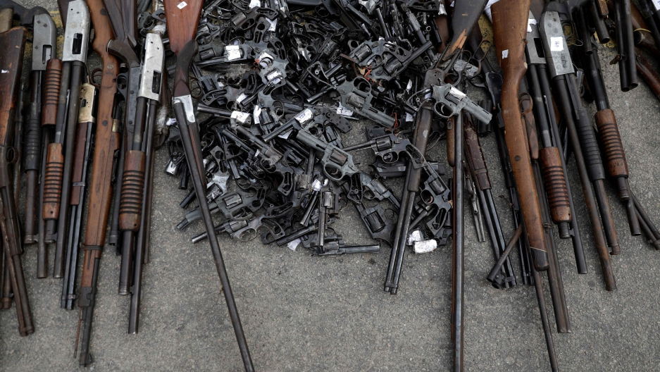 Some of about 4,000 guns seized by Brazil's Federal Police or delivered by residents during a public disarmament campaign, are pictured before being destroyed in Rio de Janeiro on June 2, 2017.