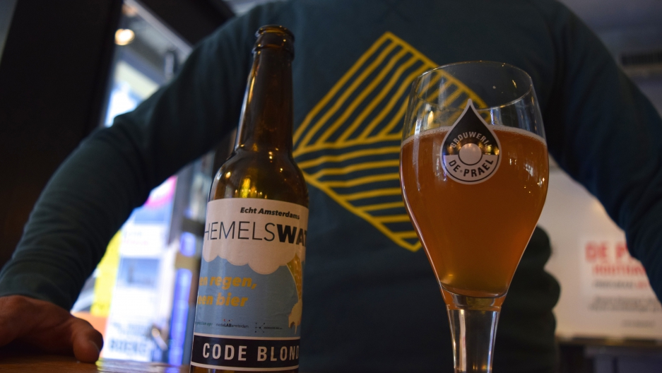"From the rooftop to the bottle: Joris Hoebe's Hemelswater beer (""Heaven's water"") is part of a citywide effort to control flooding in Amsterdam."