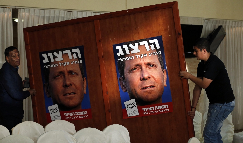 Posters of Isaac Herzog, who heads the center-left Zionist Union coalition. General elections will be held in Israel on March 17.