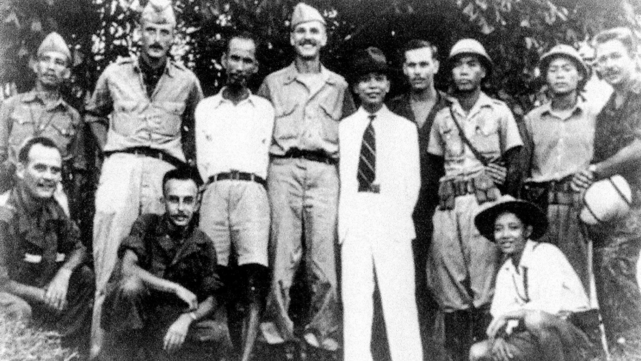 Ho Chi Minh (standing, third from left), and Vo Nguyen Giap (in white suit), with an OSS team in 1945