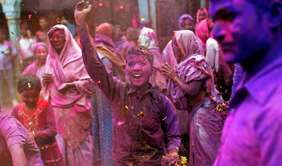 People take part in the Holi celebrations in the northern Indian state of Uttar Pradesh.