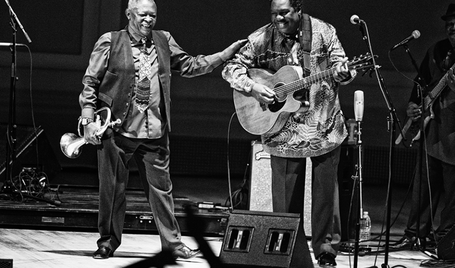 Hugh Masekela and Vusi Mahlasela on stage October 14, 2014, at Carnegie Hall in New York.