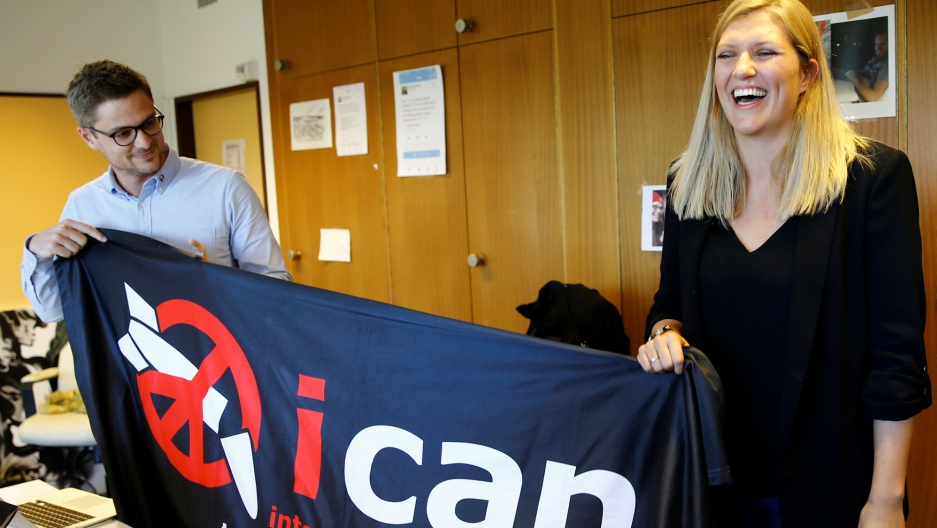 Beatrice Fihn (right), executive director of the International Campaign to Abolish Nuclear Weapons (ICAN) and Daniel Hogsta, coordinator, celebrate after winning the Nobel Peace Prize.