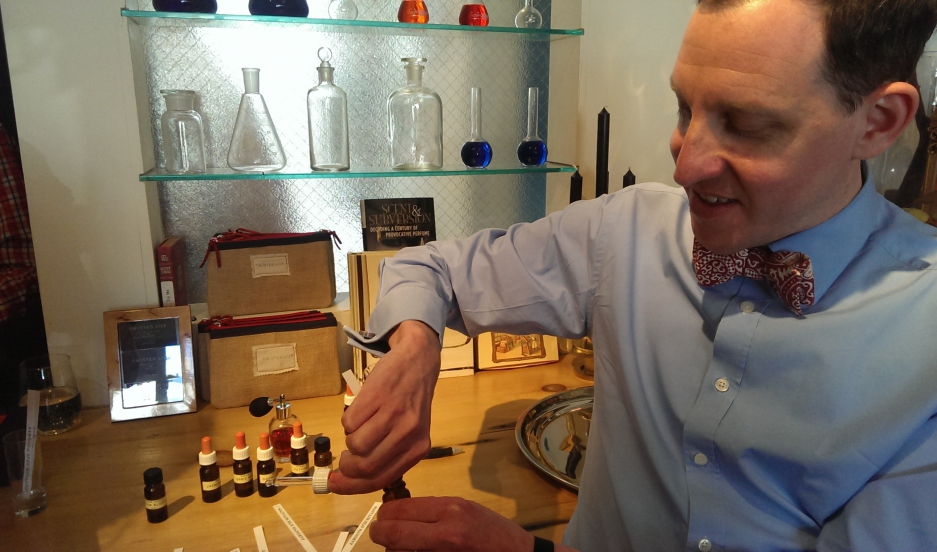 Hiram Green shows off some of the raw essences that go into his perfumes. He's at Twisted Lily, a fragrance boutique in Brooklyn.