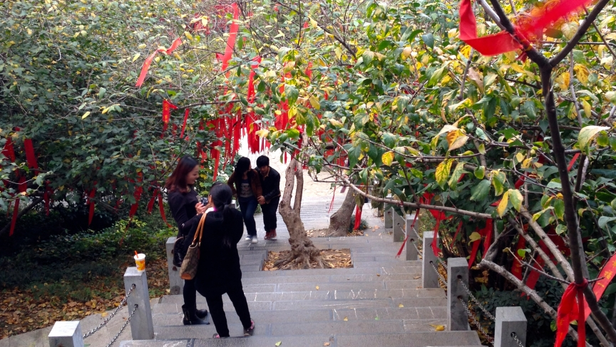 A shrine in Xuanwu Lake park in Nanjing is a popular spot where people submit personal wishes - written on red ribbons - to a higher power.