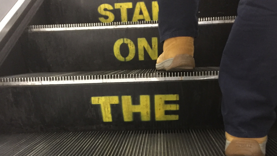 """The words, """"Stand on the right,"""" painted into an escalator in London."""
