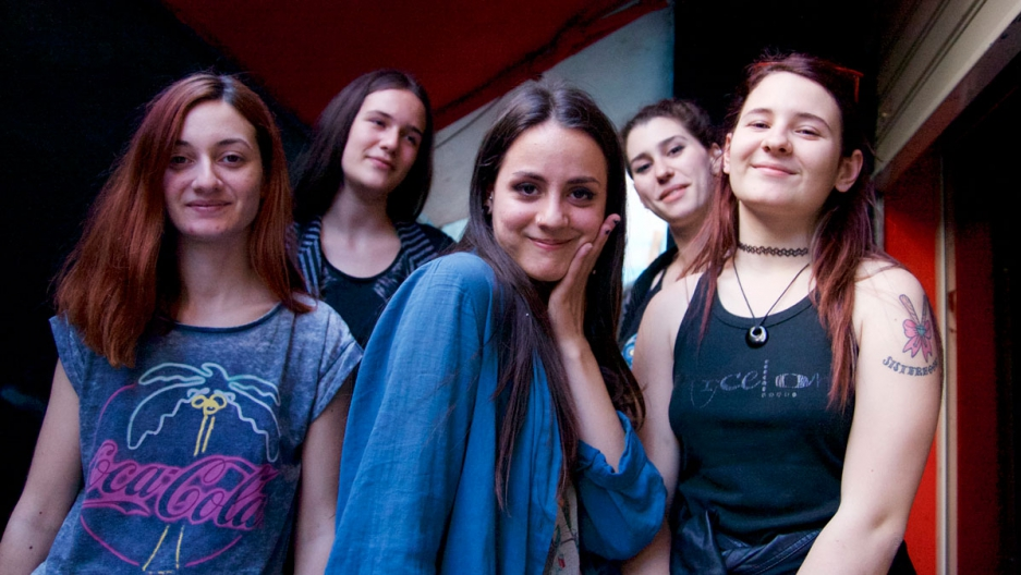 Uendi Pustina (R) and members of the band PreMenstrual Syndrome.