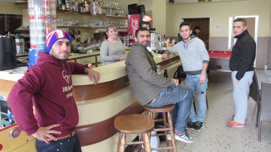 Bartender and Café Elleboode owner Laura Six welcomes Kurdish migrants from a nearby refugee camp.