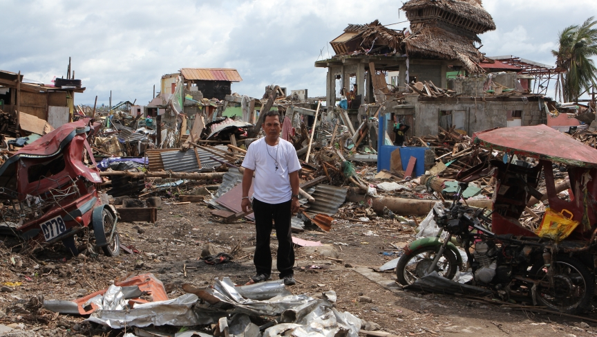"Rene Celis stands in the ruins of Barangay Pampango, a seaside neighborhood in Tacloban that was destroyed by Typhoon Haiyan. Celis was the neighborhood leader—or ""captain."""