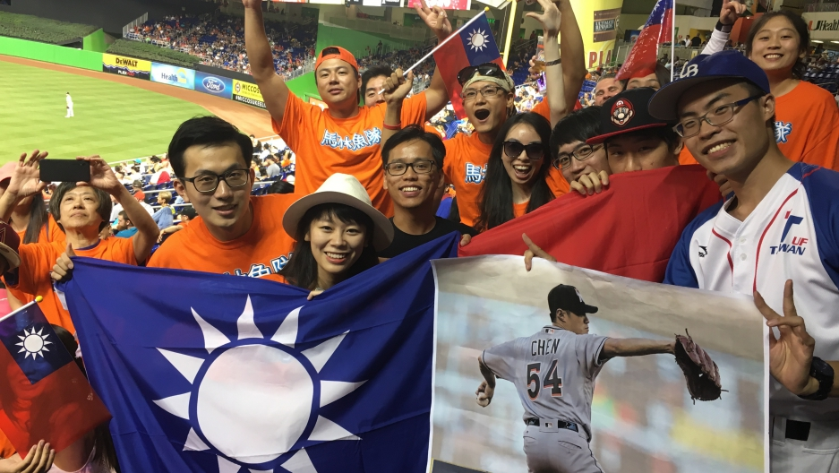 Henry Chen, on the far right holding the Chen sign, drove nearly 340 miles from Gainesville, Fla., to Miami to participate in Taiwanese Heritage Night at Marlins Park with some of his fellow students from Taiwan.