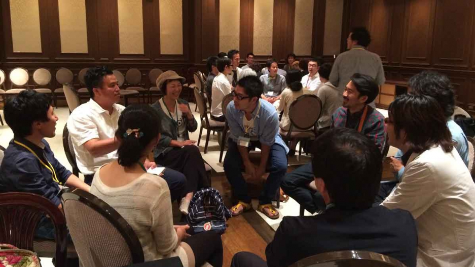 Participants at the Kamacon town meeting break into groups and brainstorm about the potential projects.