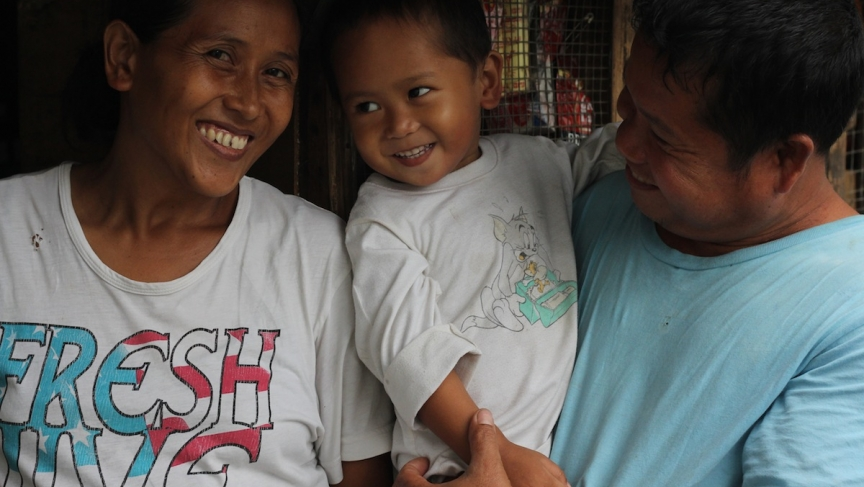 Jing Geronimo, inmate Roberto Maanyo, and their son Robert James outside the small shack the family shares on the grounds of the Leyte Provincial Prison on the outskirts of Tacloban.