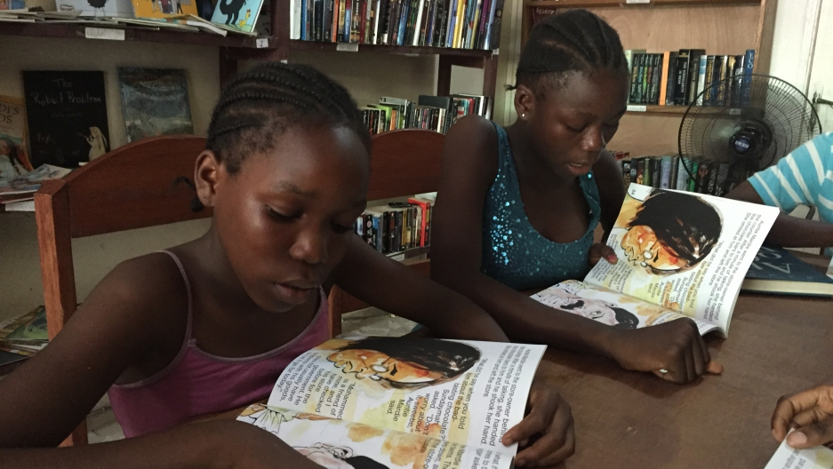 "Children reading ""Gbagba"""