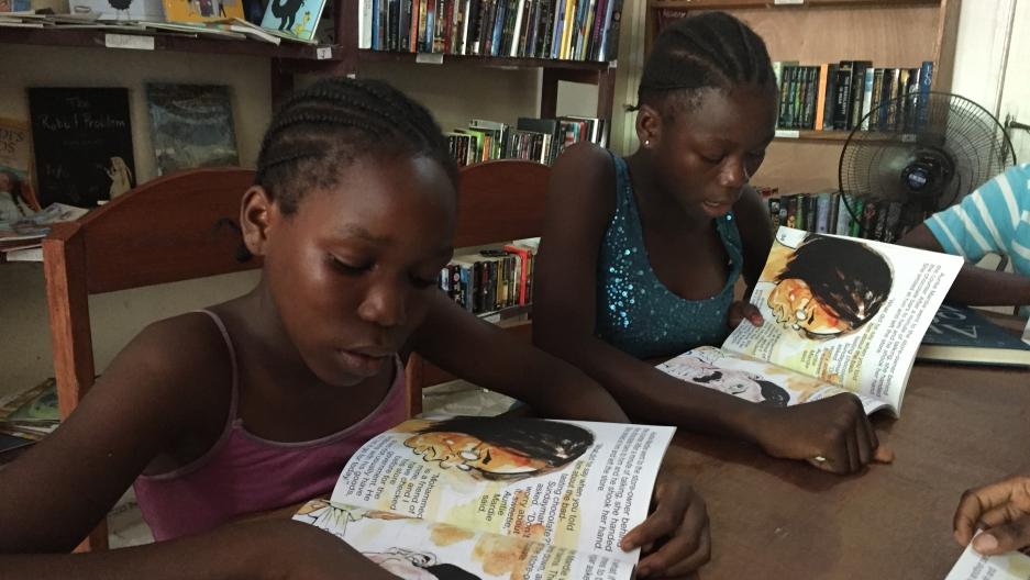 "Children reading ""Gbagba"""