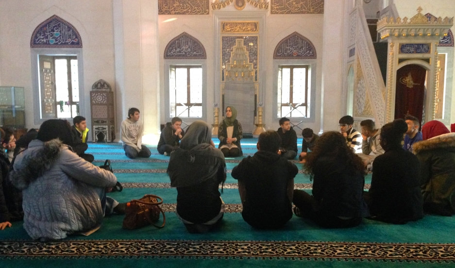 Betul Ulusoy (center back) leads an educational tour of Sehitlik Mosque in Berlin.