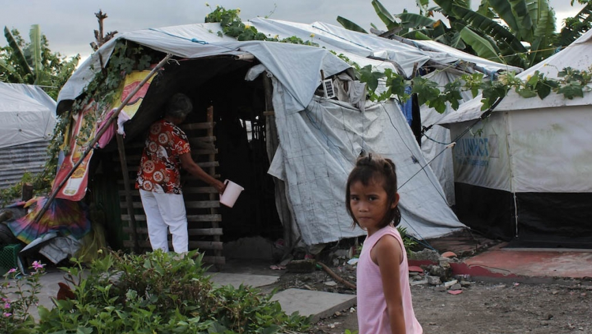 One year after Typhoon Haiyan, about 5,000 people still live in evacuation centers or tents like this one in Sandy Beach, near Tacloban.