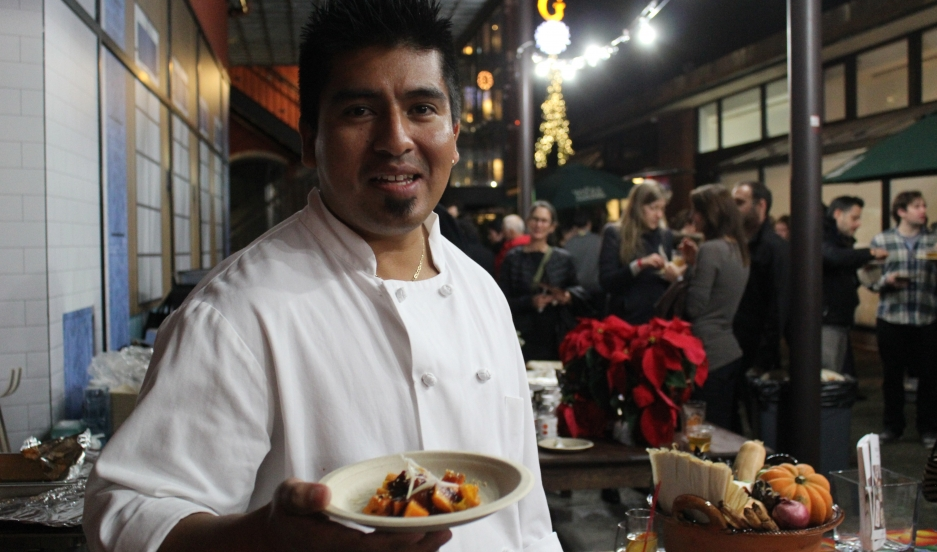 """Gonzalo Guzmán, co-chef at San Francisco's Nopalito, shows off his """"tablecloth-staining"""" mole."""