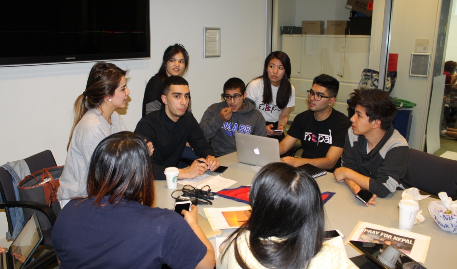 Nepali students at the University of Massachusetts Boston work on their fundraising plan for earthquake relief efforts