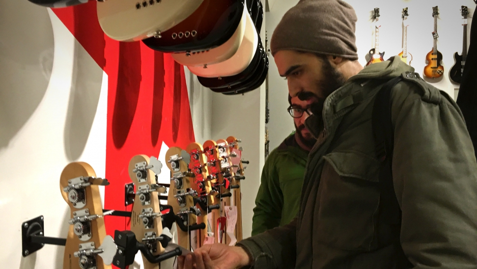 Anas Maghrebi at a music store in central Berlin. He and his Syrian band Khebez Dawle turned their journey from Turkey to Germany into a series of concerts.