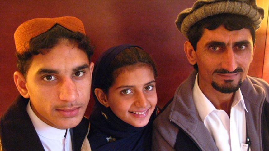 Zubair Rahman (13), his siter Nabila (9) and their father Rafiq in New York.