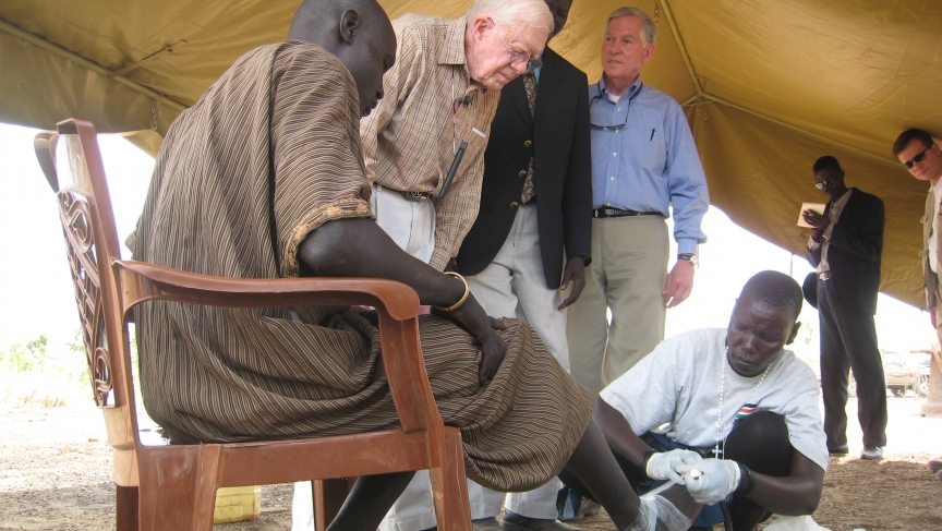 Former US President Jimmy Carter looks on as herder Garbino Kenyi is treated for Guinea worm in South Sudan.