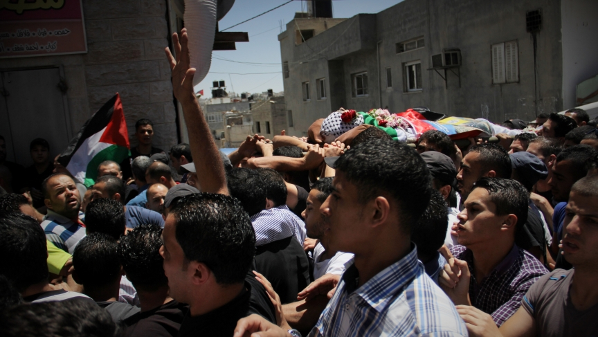 Palestinians carry the body of 17-year-old Mohammed Al-Araj through the streets of the Qalandiya refugee. He was killed in clashes with the Israeli Army.