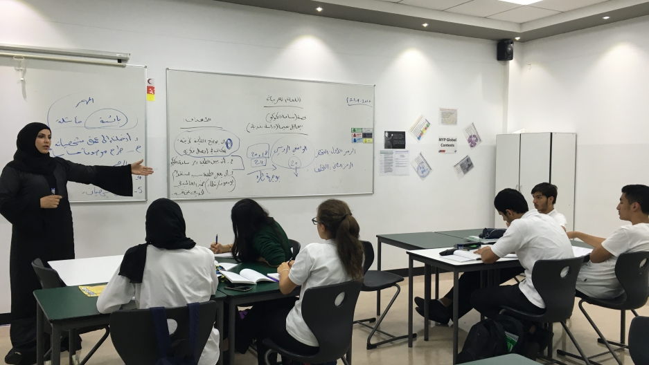 A teacher and her students at an advanced Arabic class at a private school in Dubai.