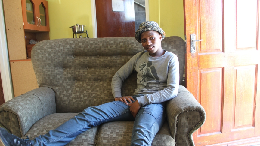 Sive (SEE-vay), a South African high school student, enjoys his new couch.