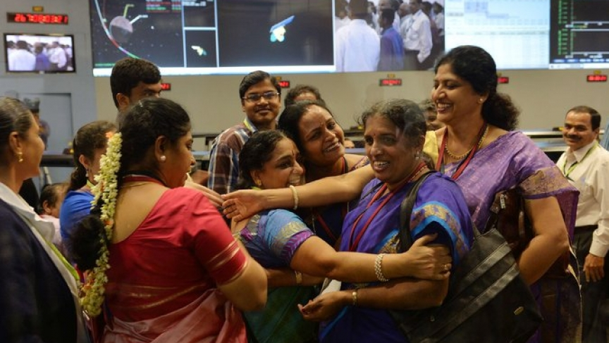 Staff from the Indian Space Research Organization celebrate at the ISRO Telemetry, Tracking and Command Network in Bangalore after their Mars Orbiter spacecraft successfully entered Mars orbit on September 24, 2014.