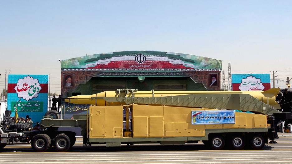 A military truck carrying a Qadr H missile drives past pictures of Iran's Supreme Leader Ayatollah Ali Khamenei (R) and late leader Ayatollah Ruhollah Khomeini during a parade marking the anniversary of the Iran-Iraq war (1980-88), in Tehran on September