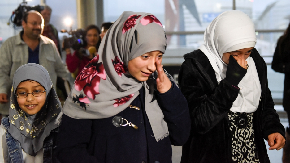 Twelve-year-old Eman Ali of Yemen was reunited with her sister Salma, right, at San Francisco International Airport in San Francisco, California, on Feb. 5.