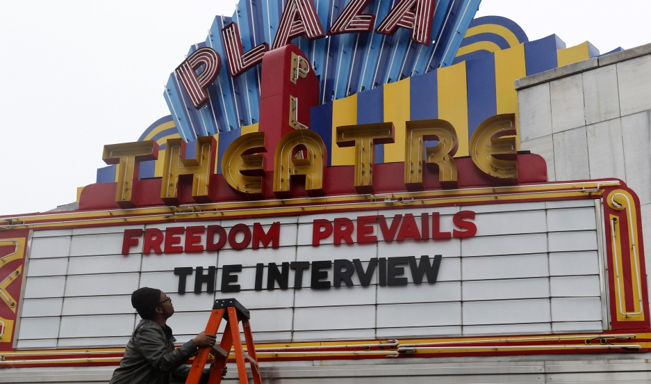 """General Manager Brandon Delaney looks up at the marquee sign after the announcement that the Plaza Theatre would be showing the movie """"The Interview"""" beginning Christmas Day in Atlanta, Georgia December 23, 2014."""