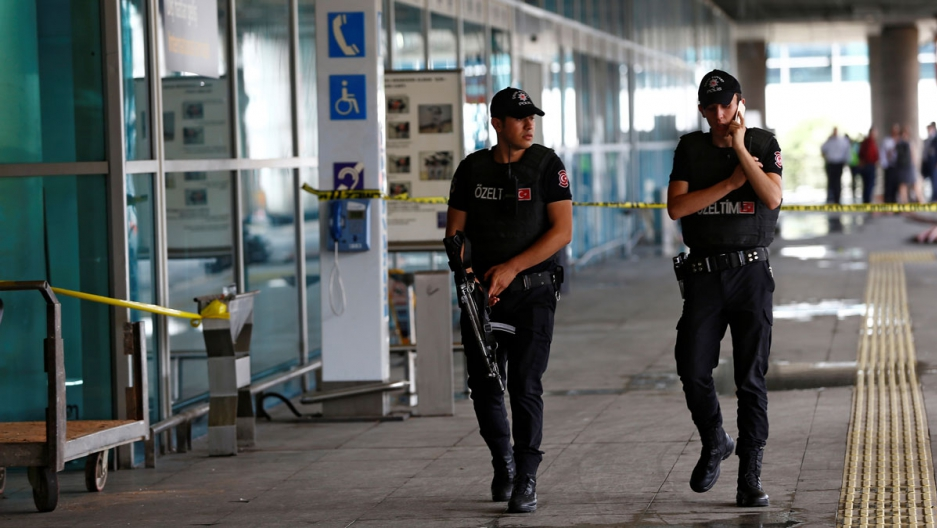 Police officers patrol at Turkey's largest airport, Istanbul Ataturk, following Tuesday's attacks.