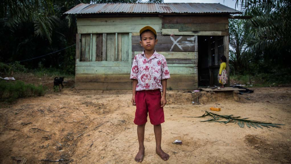 Four years after a forced eviction from ancestral land, the father of 9 year old Revan Pragustiawan says his son is traumatized and afraid to meet people.