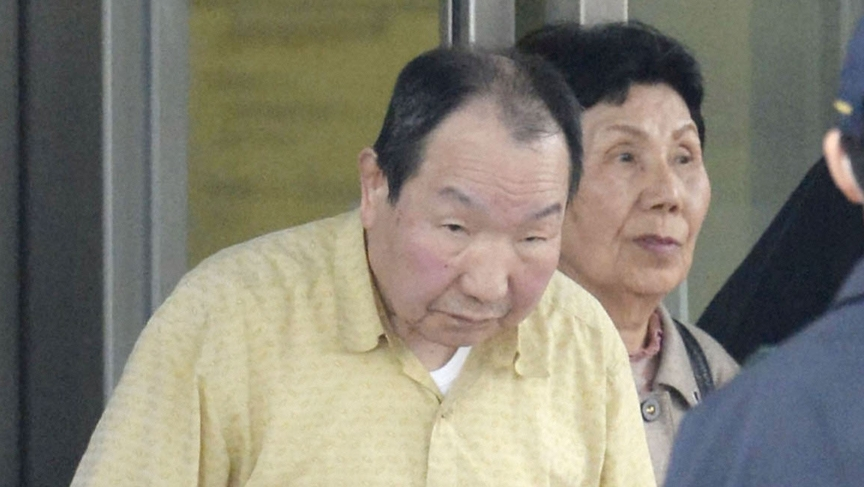 Death row inmate Iwao Hakamada (L), flanked by his sister Hideko, is released from Tokyo Detention House in Tokyo, in this photo taken by Kyodo March 27, 2014.
