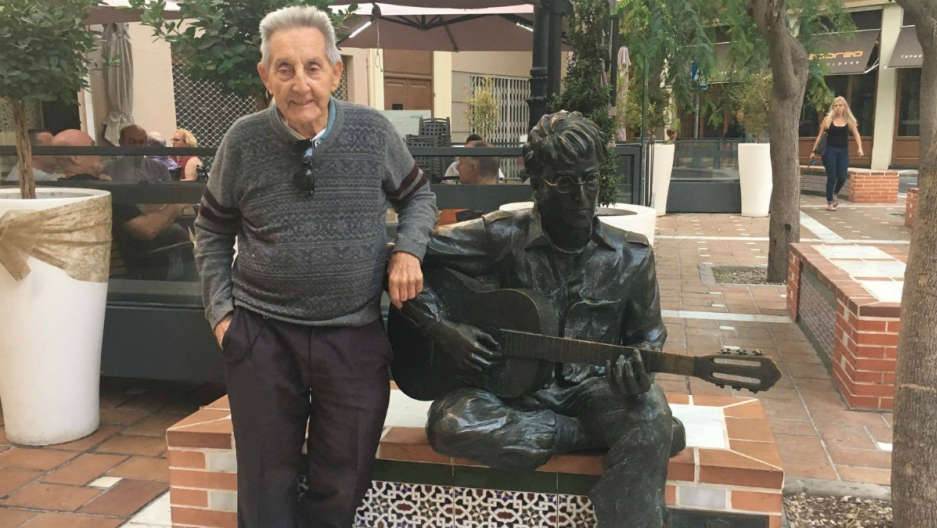 Juan Carrion poses with a statue of John Lennon in Almeria, Spain.