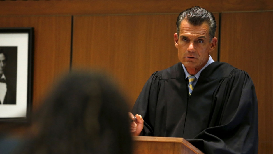 Los Angeles Superior Court Judge Craig Mitchell talks to a defendant.