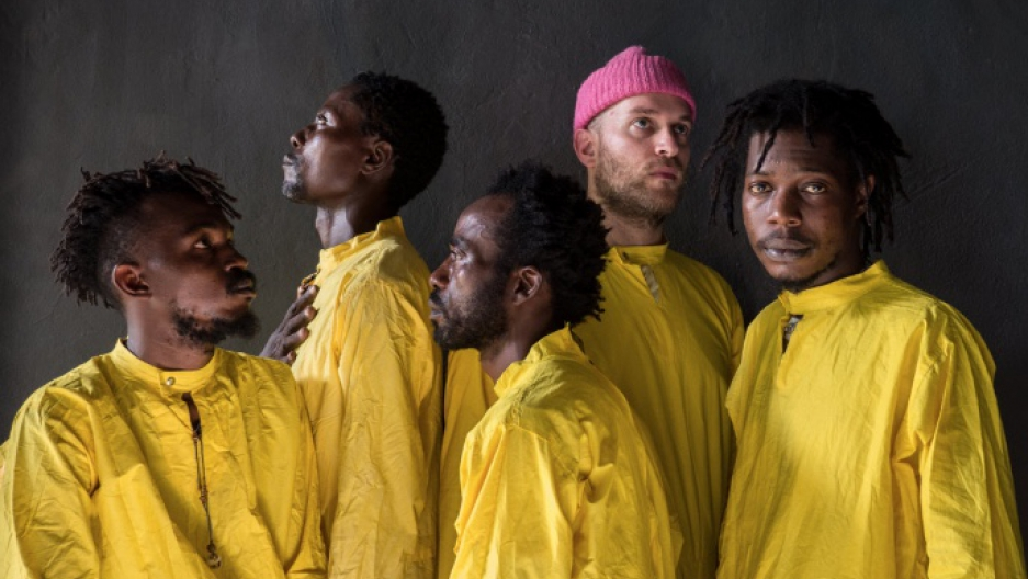 Congolese Collective KOKOKO! in yellow jumpsuits
