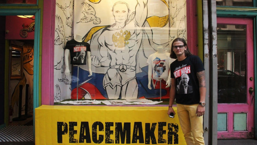 """Julius Kacinskis outside of """"Peacemaker,"""" the pop-up shop on East 20th Street in Manhattan where he sells Vladimir Putin t-shirts that he designed. """"People portray Putin as a mean guy,"""" Kacinskis says, """"so we gotta educate people."""""""