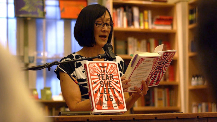 "Author Kathryn Ma reading from her first novel, ""The Year She Left Us,"" at a bookstore in Berkeley, California."