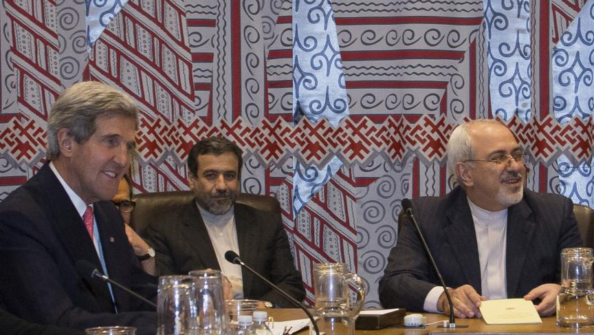 US Secretary of State John Kerry (L) and Iran's Foreign Minister Mohammad Javad Zarif (R) are seated during a meeting at the United Nations.