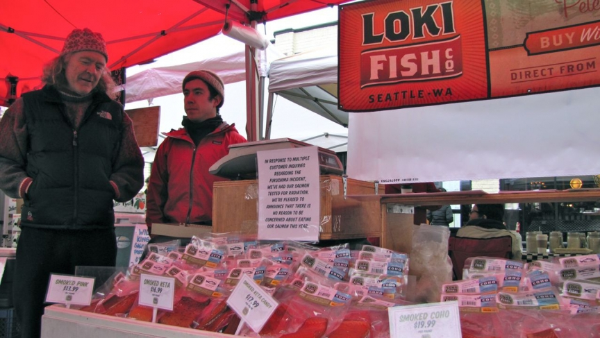 "Pete Knutson and his son Dylan sell local Pacific salmon at outdoor markets around the Seattle area. The sign on their stall at a recent market in Seattle's Ballard neighborhood reads, ""In response to multiple customer inquiries regarding the Fukushima i"